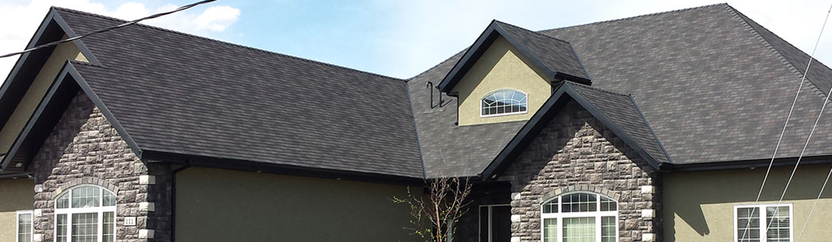 Madge Roofing Inc two story home roof