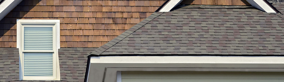 Madge Roofing Inc shingles house roof